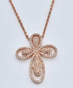 pink gold diamond cross swirl design