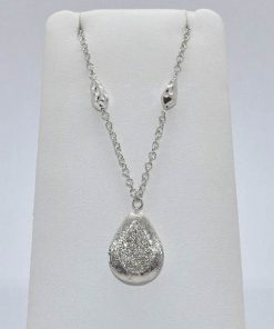 pear shaped pendant with pave diamond center