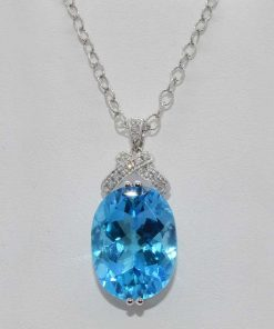 Oval Shaped Blue Topaz and Diamond Pendant