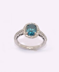 blue oval diamond engagement ring